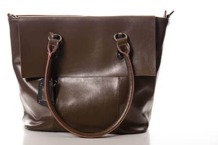 vanity bag: brown leather female bag on a white background