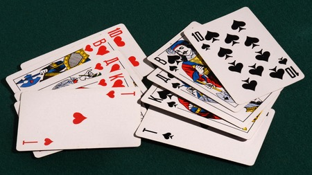 flush: royal flush of playing cards on the table.