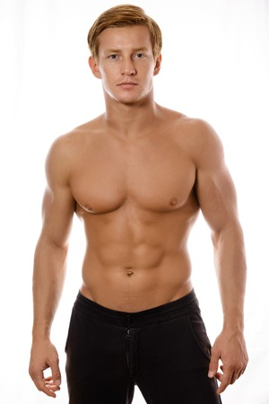 naked black men: young sexy muscular macho man posing with naked torso on white background