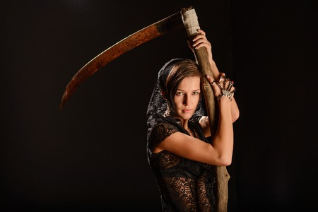 smock: Girl in a black lace smock with a scythe of death. concept