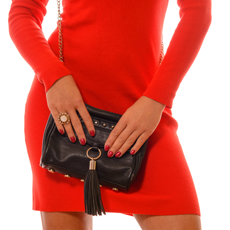 red evening: Fashionable woman with a black bag in her hands and red evening dress