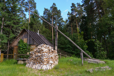 Small Hut In The Garden With Firewood. Stock Photo, Picture And Royalty  Free Image. Image 58704837.