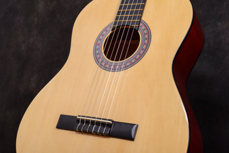 middle joint: Acoustic classical guitar. Close-up deck and strings. Stock Photo