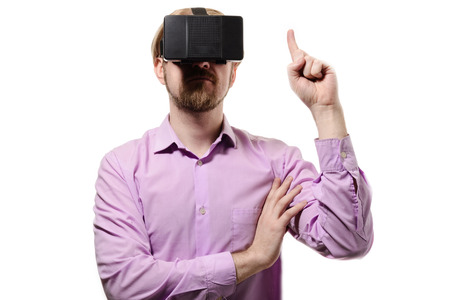 ber: nice man with glasses of virtual reality in a lilac shirt on white background.
