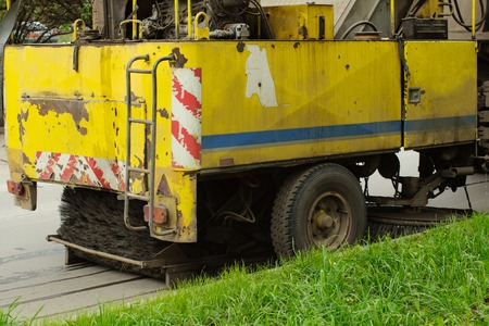 detail of a street sweeper machine car cleaning the road. Stock Photo