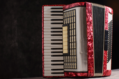 overtone: Mother of pearl accordion on a black background.
