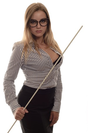 stringent: Sexy girl with glasses Strict teacher a long black skirt and striped shirt with a pointer in his hand isolated on white