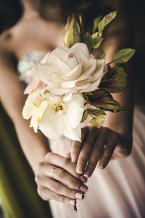 Bride holding wedding flowers bouquet.