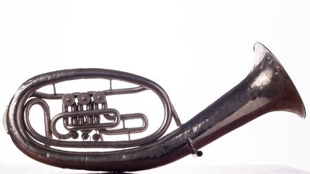 saxhorn: Backside Alto saxhorn close up isolated on white. Stock Photo