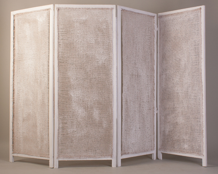 screen partition: Old white folding wooden screen isolated on a gray background.