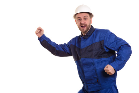 Beard man builder in hard hat and overalls runs for construction isolated on the white background. Banco de Imagens