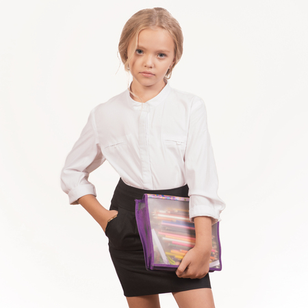 portrait of a smiling schoolgirl in uniform with pencil case - Image Stockfoto