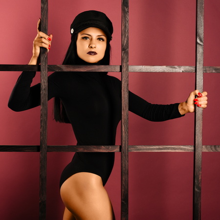 Beautiful woman girl sexy model dressed in black lingerie outfit body swimsuit and cap as prisoner - Image Standard-Bild - 116623403