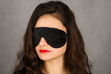 Gorgeous young woman with black sleep mask - Image
