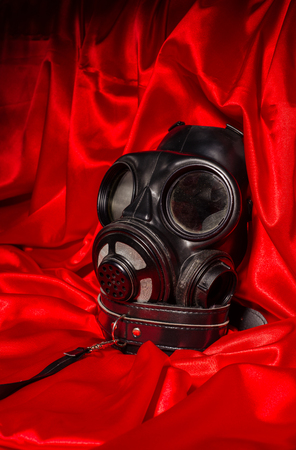 Close up bdsm outfit. Bondage, kinky adult sex games, kink and BDSM lifestyle concept with gas mask, with collar