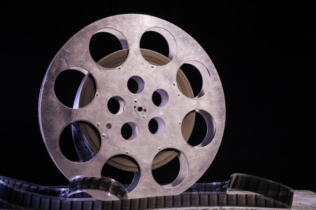 35 mm film reel with dramatic lighting on a dark background - image Imagens