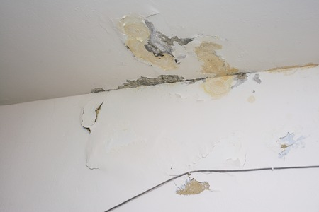 Damage ceiling from water pipelines leakage. Housing problem concept - image Stock Photo