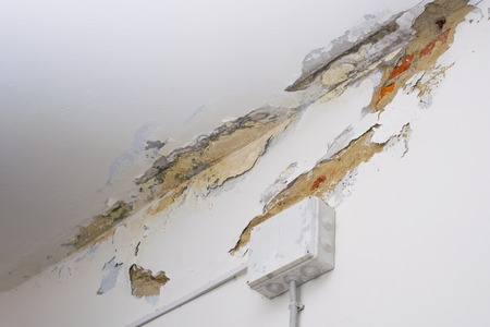 Damage ceiling from water pipelines leakage. Housing problem concept - image