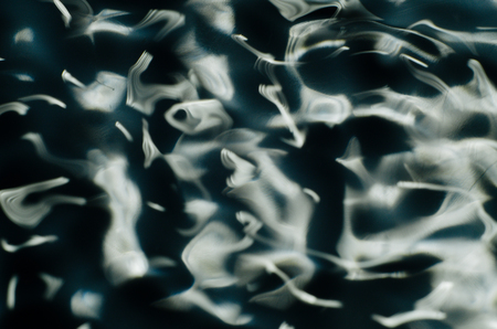 Close up texture of water under the influence of vibration in 432 hertz - image