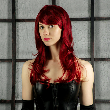 Portrait of Red-haired girl in a leather corset - image Stock Photo