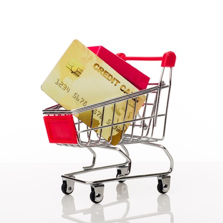 Shopping cart with credit card and copy space on white background - image Imagens