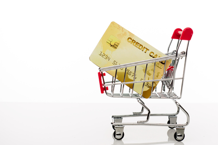 Shopping cart with credit card and copy space on white background - image