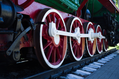 Detail of wheels of a vintage steam train locomotive - image