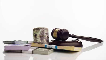 Judge's gavel and packs of dollars and euro banknotes on a white background. The concept of growing national debt- image Stock Photo - 125480196