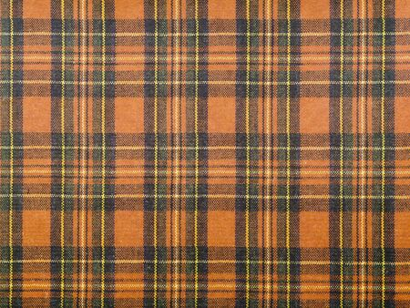 Red plaid pattern tartan background the classic Scotland fabric. - image