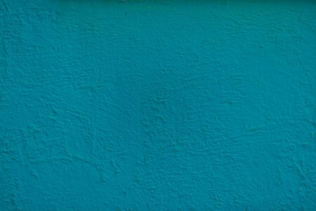 Green background facade plaster. Exterior building structure backdrop. Silica sand cement wall.
