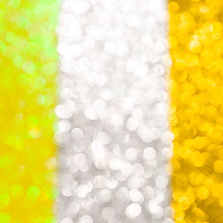 Abstract Christmas background wallpaper diamond and effect lighting for design. Golden yellow and silver bokeh glitter lights