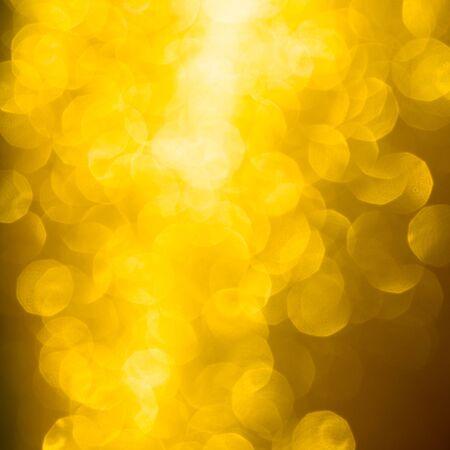 Abstract Christmas background wallpaper diamond and effect lighting for design. Golden bokeh glitter lights 写真素材
