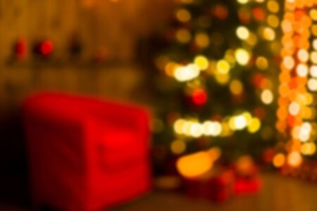 Christmas home room with tree and festive bokeh lighting, blurred holiday background. Template Stock Photo