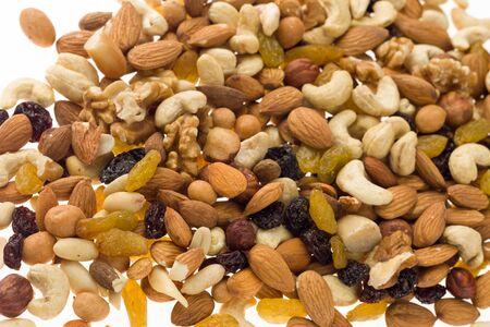 Mix of nuts and dried fruits. Cashew, almonds, macadamia, hazelnuts, Brazilian, walnuts, raisins, peanuts - image