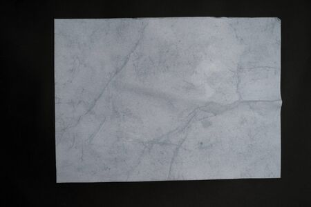 Wet white paper glued to the wall. Wet paper texture. - image Stock Photo