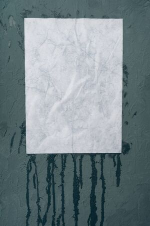 Wet white paper glued to the wall. Wet paper texture. - image Zdjęcie Seryjne