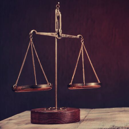 Law scales on table. Symbol of justice - Image toned 版權商用圖片