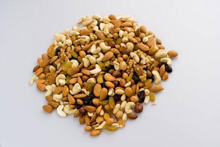 Mix of nuts and dried fruits. Cashew, almonds, macadamia, hazelnuts, Brazilian, walnuts, raisins, peanuts - image Zdjęcie Seryjne - 138554560