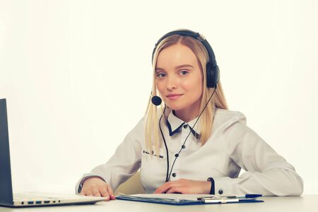 Portrait of happy smiling female customer support phone operator at workplace. - Image toned