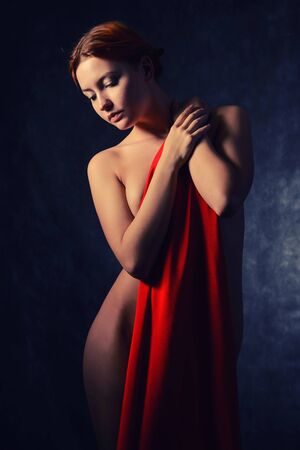 Beautiful woman with red tissue around her waist Imagens