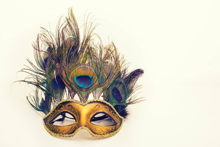 carnival mask with peacock feathers on white background