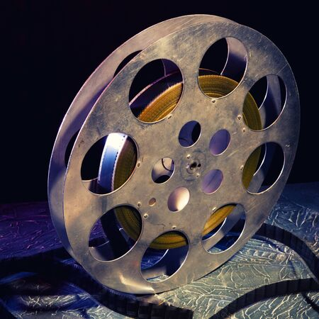 35 mm film reel with dramatic lighting on a dark background - image Toned