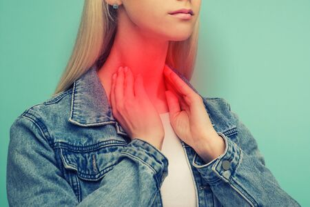 A young girl has a sore throat. Thyroid problems - Image toned