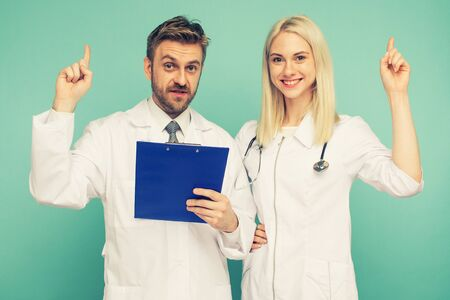 Friendly Male and Female Doctors. Happy medical team of doctors. - Image toned