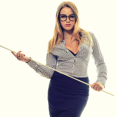 Sexy girl with glasses Strict teacher a long black skirt and striped shirt with a pointer in his hand isolated on white