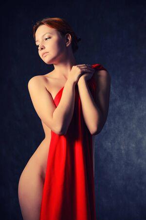 Beautiful woman with red tissue around her waist Foto de archivo