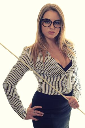 Sexy girl with glasses Strict teacher a long black skirt and striped shirt with a pointer in his hand isolated on white Standard-Bild