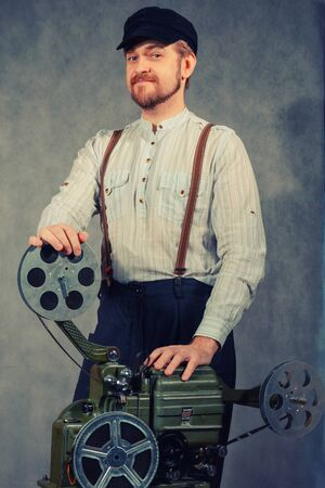 Cameraman with with a film projection
