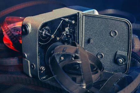 internal parts of an open old movie camera on the table.