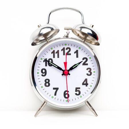 Metal retro alarm clock on white background - image